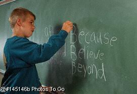 Male grade school student at blackboard